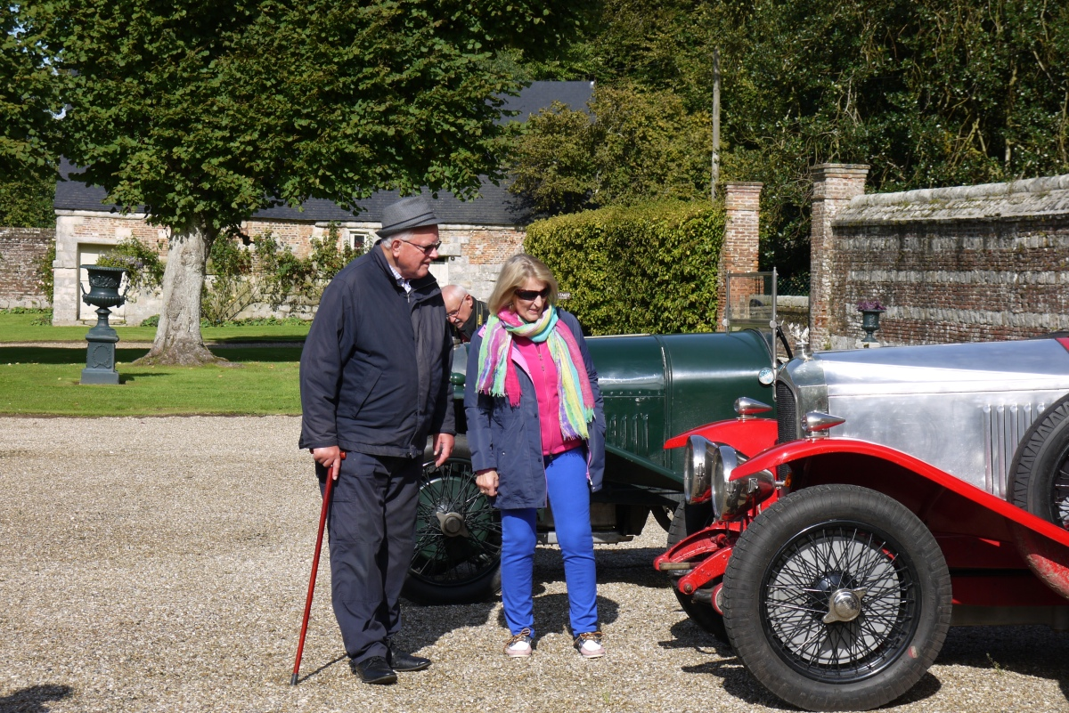 Visitors admire the vintage cars.